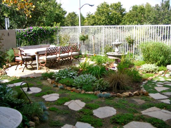 exterior-backyard-landscape-design-pretty-design-ideas-of-diy-back-with-rectangle-shape-white-wooden-outdoor-table-and-brown-metal-chairs-color-seats-also-stone-fountain-garden-path-borders-fences-gre
